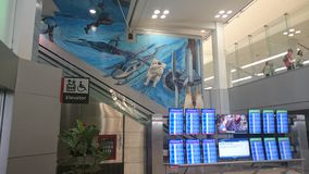 Philadelphia international departures with astronaut Stock Photography