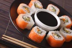 Philadelphia Maki Sushi made of Raw Salmon, Cream Cheese and Cuc Royalty Free Stock Image