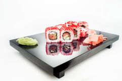Philadelphia Maki Sushi - Roll with smoked salmon, cream cheese, shrimp, cucumber inside. Royalty Free Stock Photos