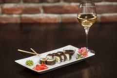 Philadelphia maki sushi rolls with salmon, cheese cream and cucumber Stock Photos