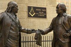 Philadelphia, PA, USA - May 29, 2018: Statue of Benjamin Franklin handing a Masonic apron to George Washington in front. Of Masonic Temple in Philadelphia stock photography