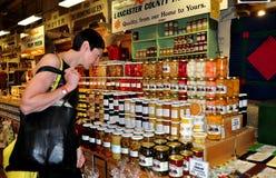 Philadelphia, PA: Woman Shopping at Reading Terminal Market stock photos