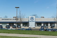 Acura automobile dealership sign and logo. stock photos