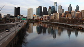 A Philadelphia, Pennsylvania cityscape with river in the foreground stock footage