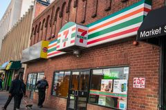 The front entrance and sign for the seven eleven mini market store located on Market Street in Center City, Philadelphia stock photo