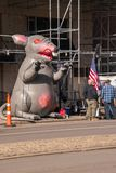 Inflatable rat is seen on the city street in front of a non-union construction site with protestors seen nearby stock photos
