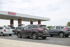 Costco gas station with customers refueling.