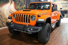 Philadelphia, Pennsylvania, U.S.A - February 9, 2020 - The side view of the bright red of a 2020 Jeep Gladiator Rubicon 4X4