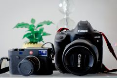 Canon EOS 1DX mark ii and Leica m10 camera royalty free stock photography