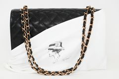 Photo of black Chanel handbag brand Editorial on white background. Philadelphia, Pennsylvania, USA, August 10, 2018: Photo of black Chanel handbag brand royalty free stock image
