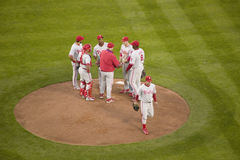 Philadelphia Phillies coach. Pitcher and infielders meeting on mound during National League Championship Series (NLCS), Dodger Stadium, Los Angeles, CA on stock photo