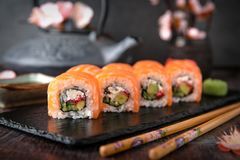 Philadelphia roll sushi with salmon, cucumber, avocado, cream cheese, tobiko caviar. Sushi menu. royalty free stock image
