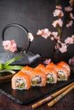 Philadelphia roll sushi with salmon, smoked eel, cucumber, avocado, cream cheese, red caviar. Sushi menu royalty free stock photos