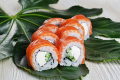 Philadelphia Roll Sushi tropical leaves still life Royalty Free Stock Images