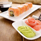 Philadelphia roll sushi on a white plate with soy sauce wasabi a Royalty Free Stock Photography