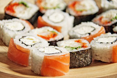 Philadelphia rolls. On a wooden plate Royalty Free Stock Photography