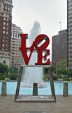 Philadelphia's Love Statue - Love Park. PHILADELPHIA - JUNE 11: The famed Love statue with a running fountain as the city weighs options in the budgets to keep Royalty Free Stock Photo