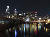 Philadelphia Skyline at Night. The downtown Philadelphia skyline at night with reflections in the Schuylkill River Stock Images