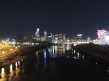 Philadelphia Skyline at Night. The downtown Philadelphia skyline at night with reflections in the Schuylkill River Royalty Free Stock Image