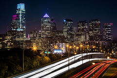 Philadelphia skyline by night. On October 2, 2013 in Philadelphia. The rush hour traffic leaves trails of light on Schuylkill expressway Royalty Free Stock Photo