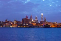 Philadelphia skyline. Reflected in the Delaware river under a twilight Stock Photos