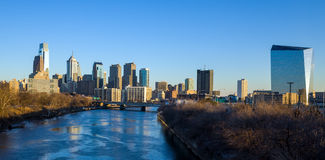 Philadelphia skyline from the Schuylkill River at sunset. Royalty Free Stock Photos