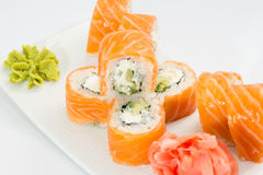 Philadelphia sushi roll with ginger and wasabi on white plate Stock Photography