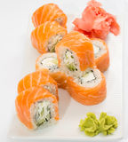 Philadelphia sushi roll with ginger and wasabi on white plate Royalty Free Stock Image
