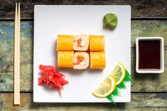Philadelphia sushi rolls on white plate. Top view Stock Photography