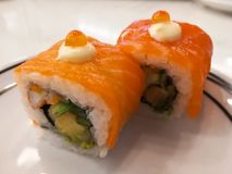 Philadelphia roll sushi with salmon, prawn, avocado, cream cheese. Sushi menu. Japanese food. Royalty Free Stock Photography
