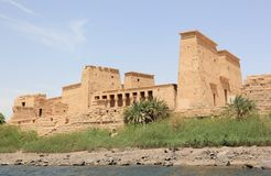 Philae temple on Agilkia Island as seen from the Nile. Egypt. Philae is an island in Lake Nasser, Egypt. It was formerly an island in the First Cataract of the Royalty Free Stock Image