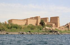 Philae temple on Agilkia Island as seen from the Nile. Egypt. Philae is an island in Lake Nasser, Egypt. It was formerly an island in the First Cataract of the Stock Photo