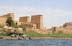 Philae temple on Agilkia Island as seen from the Nile. Egypt. Philae is an island in Lake Nasser, Egypt. It was formerly an island in the First Cataract of the Stock Image
