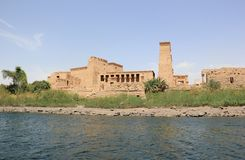 Philae temple on Agilkia Island as seen from the Nile. Egypt. Philae is an island in Lake Nasser, Egypt. It was formerly an island in the First Cataract of the Stock Photography