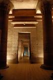 The Philae temple, Egypt. Several successive rooms in the Philae temple, Egypt. Artificially illumionated Stock Photos