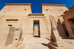 Philae Temple entrance guarded by two lion statues in Egypt. Egyptian civilization history well preserved at one of the most well known Egyptian temples in royalty free stock photo