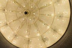 Philharmonic big-sized chandelier. Big chandelier in philharmonic hall Stock Photos