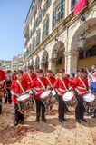 Philharmonic musicians playing in Corfu Easter holiday celebrations among crowd, Ionian, Greece. Corfu, Greece - April 27, 2019: Philharmonic musicians in the stock photography