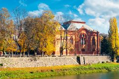 Philharmonic Orchestra Concert Hall of Uzhgorod. Uzhgorod, Ukraine - NOV 10, 2012: Philharmonic Orchestra Concert Hall on the bank of the river Uzh in autumn stock image