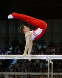 Philip Boy. Germany's Philip Boy on the parallel bars during a qualifying competition for the 2012 Olympic games in London England Royalty Free Stock Images