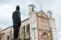 Philip II facing San Pablo Church in Valladolid. Statue of King Felipe II in San Pablo Square looking at the main facade of San Pablo Church, an Isabelline Royalty Free Stock Images
