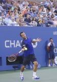 Philipp Kohlschreiber under den fjärde runda matchen på US Open 2013 mot storslagen Slam för tolv gånger mästaren Rafael Nadal Royaltyfri Foto