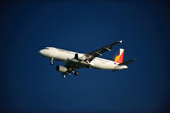 Philippine Airlines A320-214 on Final. Philippine Airlines Airbus A320-214 with landing gears and flaps down on final approach on a cloudless day Royalty Free Stock Images