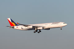 Philippine Airlines Airbus A340 aircraft on approach to land at Sydney Airport. Sydney, Australia - May 5, 2014: Philippine Airlines Airbus A340 aircraft on Stock Photo
