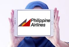 Philippine Airlines logo. Logo of Philippine Airlines on samsung tablet holded by arab muslim woman. Philippine Air Lines, is the flag carrier of the Philippines stock images