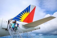 Philippine Airlines PAL at Boracay Airport in Caticlan, Philip. Unknown tourists leaving a airplane of Philippine Airlines PAL at Boracay Airport on Nov 17, 2017 Stock Photo