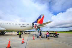 Philippine Airlines PAL at Boracay Airport in Caticlan, Philip. Unknown tourists leaving a airplane of Philippine Airlines PAL at Boracay Airport on Nov 17, 2017 Royalty Free Stock Photography