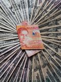 philippine banknote of twenty pesos and background with american dollars bills stock images