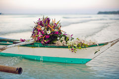 Philippine boat and a bouquet of flowers. Wedding in the tropics concept Royalty Free Stock Photography