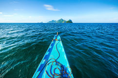 Philippine boat sails to the islands on the horizon. stock images